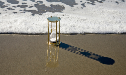 Hourglass Timer and Rising Tide Surf Seashore Beach